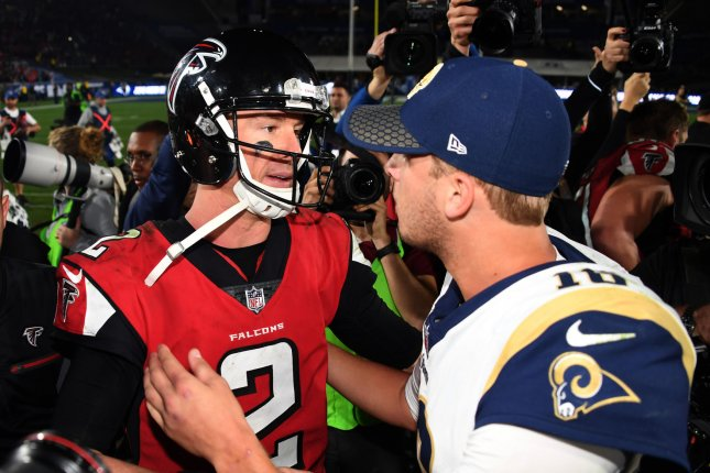Image result for saints and falcons players hug after game