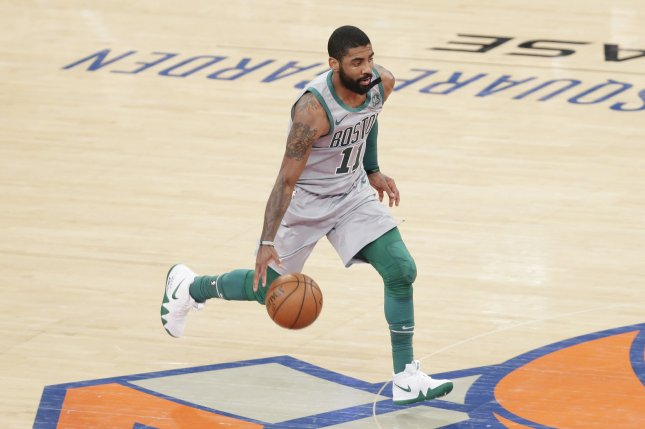 Boston Celtics guard Kyrie Irving brings the basketball up the court in the first half against the New York Knicks on Saturday at Madison Square Garden in New York City. Photo by John Angelillo/UPI