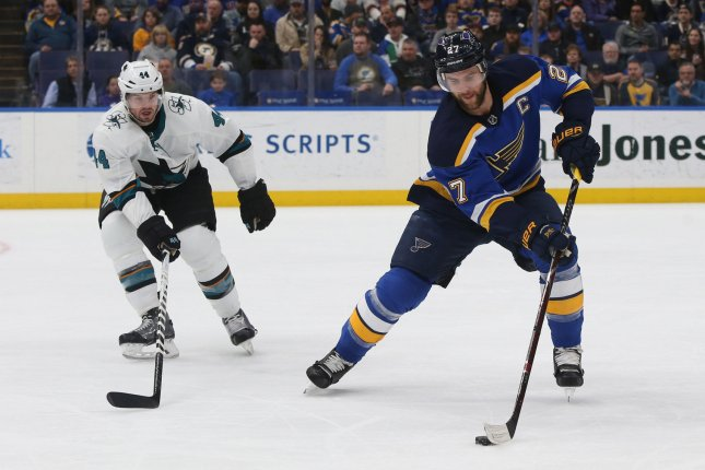 San Jose Sharks defenseman Marc-Edouard Vlasic (L) exited Game 2 after being struck high by a puck. He returned to practice Wednesday. File Photo by Bill Greenblatt/UPI
