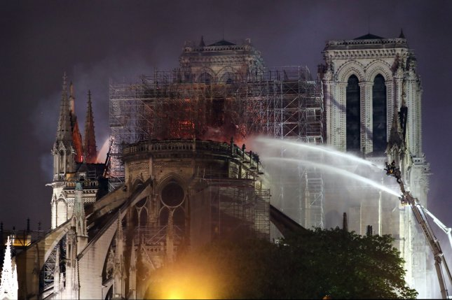 Firefighters battle to extinguish a giant fire that engulfed the Notre Dame Cathedral in Paris on April 15, 2019. Experts are debating on how best to restore the damaged building. File Photo by Eco Clement/UPI