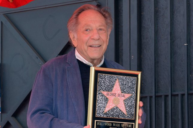 George Segal poses during a ceremony honoring him with the 2,062nd star on the Hollywood Walk of Fame on February 2017. Stars are paying homage to Segal on social media following his death. File Photo by Jim Ruymen/UPI