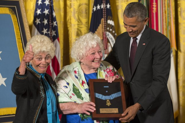 President Barack Obama awards the Medal of Honor posthumously to two World War I soldiers, Army Pvt. Henry Johnson and Sgt. William Shemin, in a ceremony in the East Room of the White House on Tuesday. Sgt. Shemin's daughters Ina Bass, left, and Elsie Shemin-Roth accepted the medal. Photo by Pat Benic/UPI