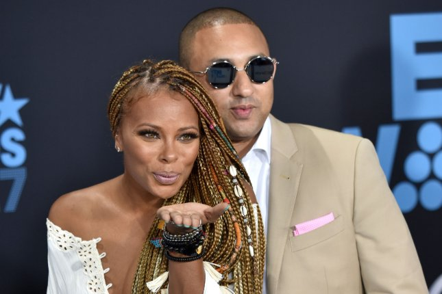 Eva Marcille (L) married Michael Sterling during Sunday's episode of The Real Housewives of Atlanta. File Photo by Christine Chew/UPI