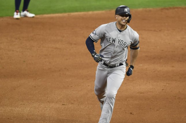 New York Yankees slugger Giancarlo Stanton runs the bases and celebrates his solo home run against the Houston Astros in the sixth inning of Game 1 of the American League Championship Series on Saturday at Minute Maid Park in Houston. Photo by Trask Smith/UPI