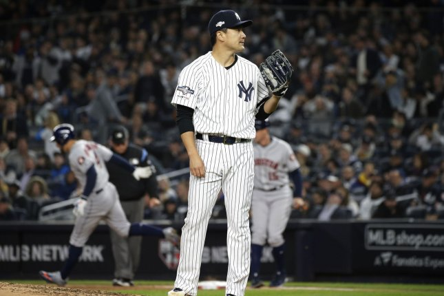 New York Yankees pitcher Masahiro Tanaka was hit in the head with a line drive and sustained a concussion Saturday at Yankee Stadium but returned to the team on Sunday. File Photo by John Angelillo/UPI
