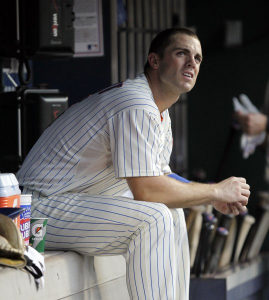 New York Mets David Wright sits in the dug out in the second inning against the Florida Marlins at Citi Field in New York City on August 2, 2011. UPI/John Angelillo