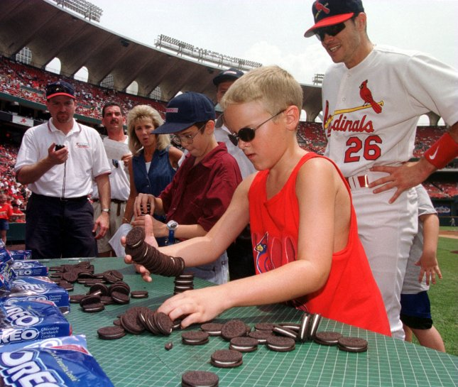 Colton Rhodes (R) watches as his cookie stack falls over as he competes against Brian Gates in the Nabisco Oreo Cookie Stacking competition at Busch Stadium. wy/bg/Bill Greenblatt UPI