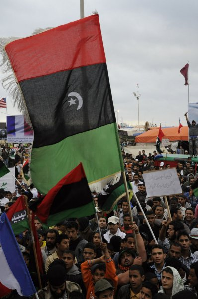 Libyans protesters hold old Libyan flags during protest against Moammar Gadhafi's regime in Benghazi in Libya, on April 28 2011. UPI\Tarek Alhuony.
