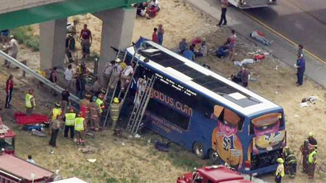 Rescue workers work to remove some of the 64 riders of a Megabus headed to St. Louis from Chicago, after a tire blowout and the bus hitting a bridge support in Litchfield, Illinois on August 2, 2012. Police say 31 people were taken to three area hospitals and three flown to Saint Louis hospitals in St. Louis. Litchfield is located along Highway 55 about 60 miles north of St. Louis. UPI/KSDK-TV