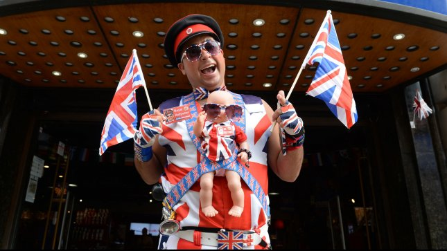 British Royal enthusiast Daniel Obanbo outside Cool Britannia, Piccadilly ahead of the birth of the first baby of The Duke and Duchess Of Cambridge in London on July 17, 2013. UPI/ Rune Hellestad