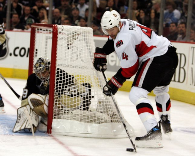 Chris Phillips lines up a shot against Pittsburgh at the Stanley Cup Playoffs on April 11, 2008. (UPI Photo/Stephen Gross)