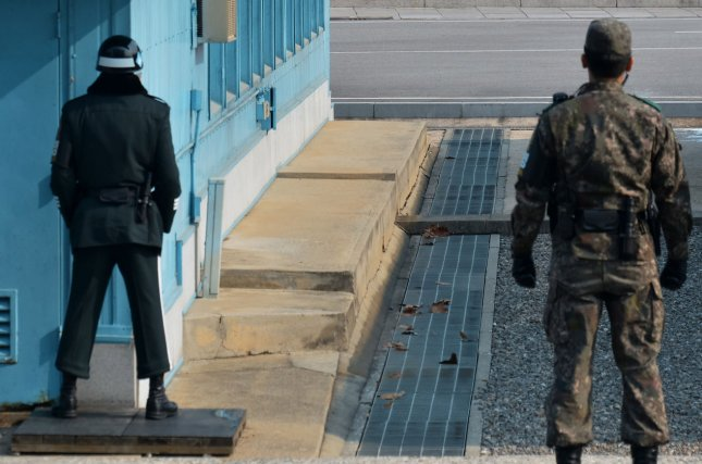 A South Korean soldier stands watching the North side at the Joint Security Area of Panmunjom in the demilitarized zone near Paju, South Korea. North Korea has requested recent defectors be allowed to meet with family members at the truce village. File Photo by Keizo Mori/UPI