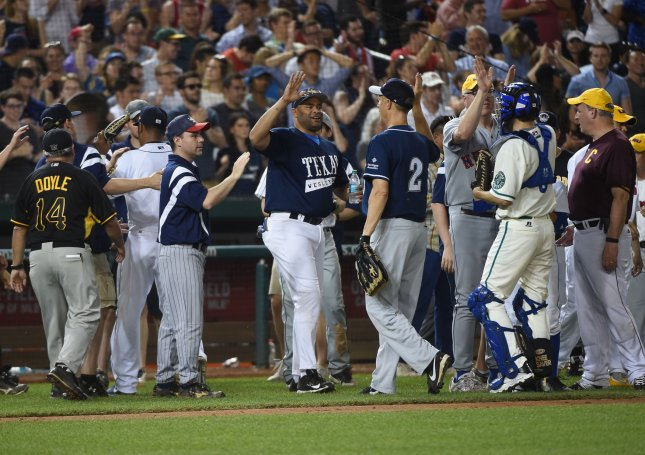 Democratic lawmakers celebrate their win over the Republicans 11-2 in their Congressional baseball game at Nationals Park in Washington on Thursday. The annual game took on added significance after Rep. Steve Scalise, R-La., was shot and critically wounded as he practiced Wednesday for the game. Photo by Molly Riley/UPI