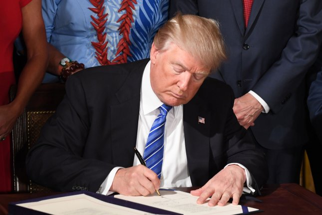 President Donald Trump signs the VA Accountability and Whistleblower Protection Act during an event in the East Room of the White House on Friday. The law makes it easier to fire problem employees at the Department of Veterans Affairs and protect whistleblowers. Photo by Pat Benic/UPI