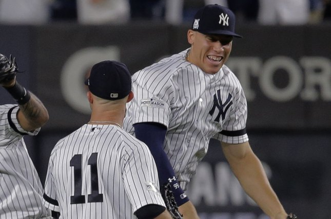 New York Yankees right fielder Aaron Judge and left fielder Brett Gardner (11) celebrate after they beat the Cleveland Indians 7-3 to even their series in game 4 of the 2017 MLB Playoffs American League Divisional Series at Yankee Stadium in New York City on October 9, 2017. Photo by Ray Stubblebine/UPI
