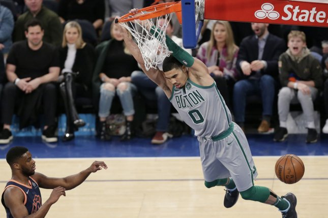 Boston Celtics forward Jayson Tatum showed off his skillset with a juke on Joel Embiid and a dunk on Ben Simmons during a win against the Philadelphia 76ers on Tuesday in Philadelphia. File Photo by John Angelillo/UPI