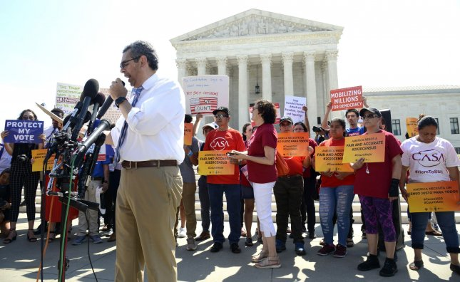 Gustavo Torres of CASA, an organization to support immigrant rights, made remarks at the Supreme Court last month as the court decided to block the citizenship question. Now, a federal judge has ordered court proceedings on whether the basis for the question was to discriminate against immigrant communities of color. File Photo by Mike Theiler/UPI