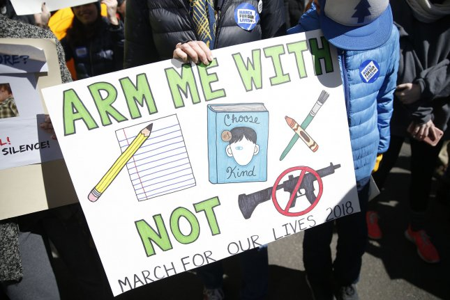 Activists oppose allowing guns in schools at the March for Our Lives rally in New York City on March 24, 2018. File Photo by John Angelillo/UPI