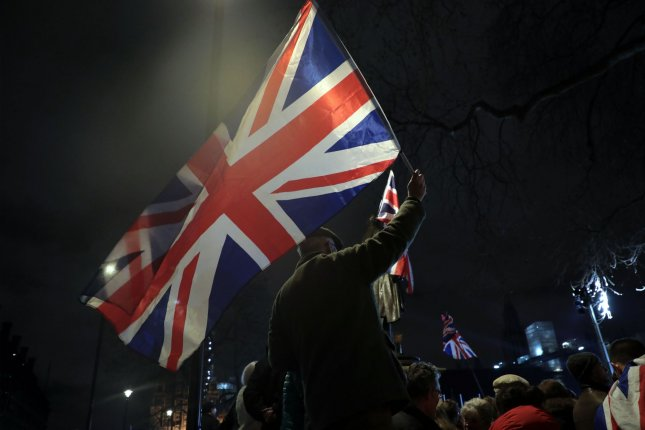 Brexit supporters celebrate plans to leave the European Union during a gathering in Parliament Square in London, Britain, on December 31, 2019. File Photo by Hugo Philpott/UPI