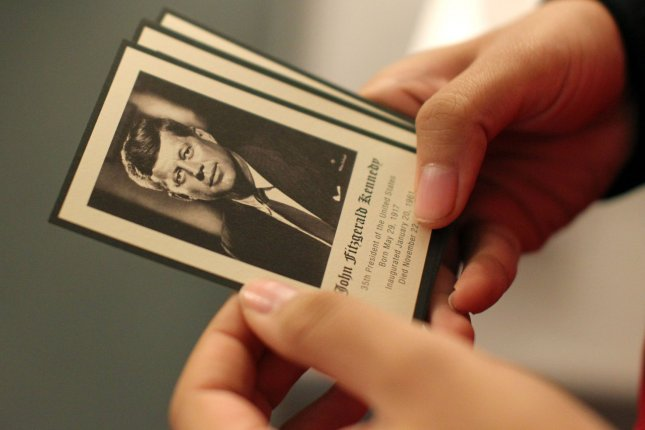 A volunteer at the President John F. Kennedy Presidential Library and Museum in Boston, hands out small cards to visitors during the 50th Anniversary of the Assassination of JFK in Dallas on November 22, 2013. UPI/Matthew Healey
