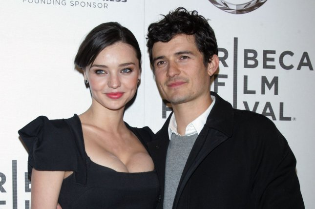 Orlando Bloom (R) and Miranda Kerr attend the Tribeca Film Festival premiere of The Good Doctor on April 22, 2011. The actor dedicated a sweet message to Kerr to mark her 34th birthday. File Photo by Laura Cavanaugh/UPI