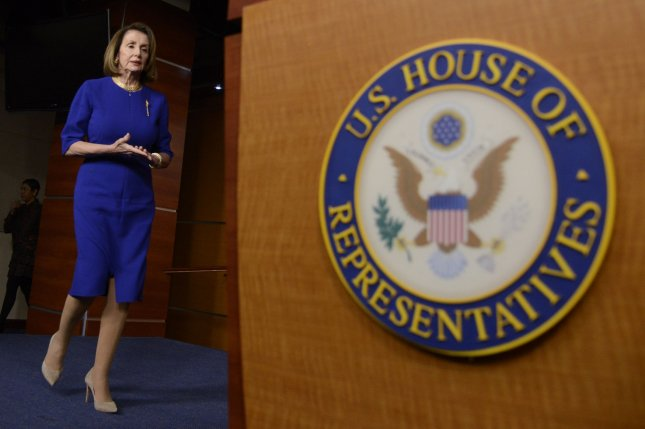 House Speaker Nancy Pelosi of California arrives for a news briefing at the U.S. Capitol on February 7. Photo by Mike Theiler/UPI