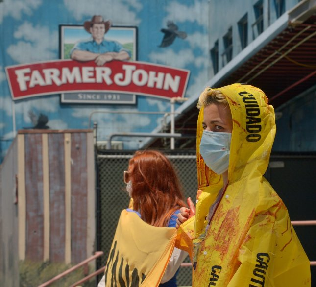A small group of activists stage a protest outside a Farmer John slaughterhouse in Vernon, Calif., on Thursday. Outbreaks of COVID-19 have struck nine industrial facilities in Vernon, including Farmer John. File Photo by Jim Ruymen/UPI