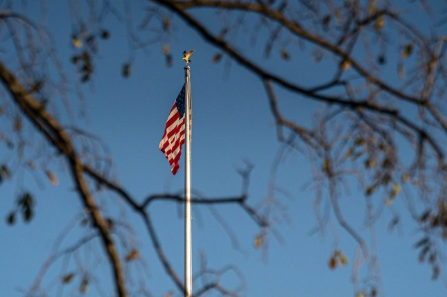The American flag is seen waving in the wind as the trees loose their leaves in the fall season in Washington, DC on Monday, November 16, 2020. Photo by Ken Cedeno/UPI