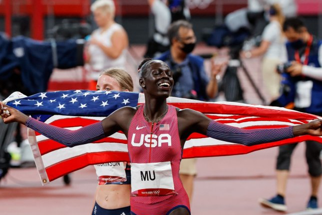 Team USA's Athing Mu drapes herself in an American flag after her win in the women's 800-meter race at the 2020 Summer Games on Tuesday in Tokyo. Photo by Tasos Katopodis/UPI