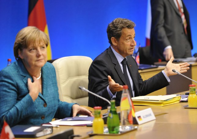 French President Nicolas Sarkozy (R) and German Chancellor Angela Merkel attend a round table meeting at the G8 Summit in Deauville, France, May 26, 2011. UPI