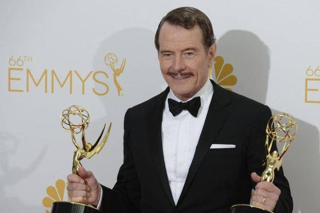 Bryan Cranston hold his Emmys at the Primetime Emmy Awards at the Nokia Theatre in Los Angeles on August 25, 2014. File photo by UPI/Phil McCarten
