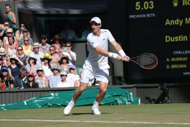 Great Britain's Andy Murray returns during his match against Germany's Dustin Brown on day three of the 2017 Wimbledon championships, London on July 05, 2017. Photo by Hugo Philpott/UPI