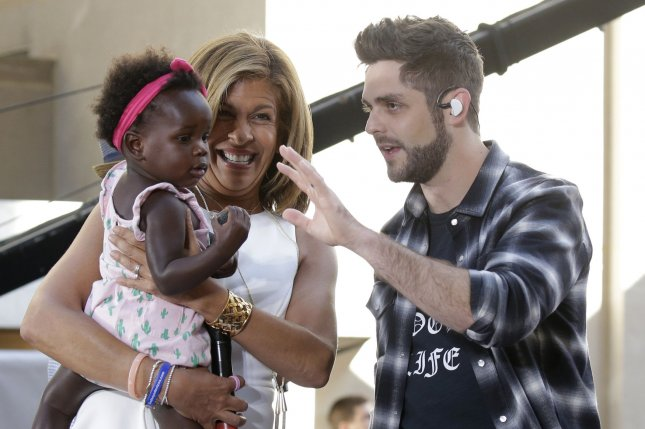 Thomas Rhett (R) with daughter Willa (L) and Hoda Kotb during his performance on Today on June 2. File The singer and wife Lauren brought Willa on a getaway to the south this week. Photo by John Angelillo/UPI
