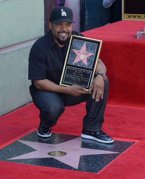 Ice Cube holds a replica plaque during an unveiling ceremony honoring him with the 2,6014th star on the Hollywood Walk of Fame in Los Angeles on June 12, 2017. The rapper and actor turns 50 on June 15. File Photo by Jim Ruymen/UPI