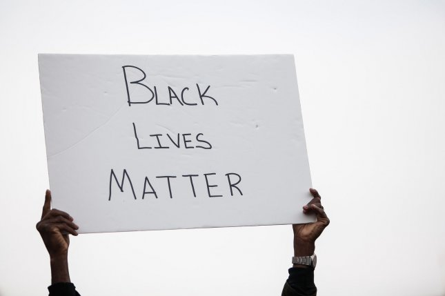 A protestor holds a sign reading Black Lives Matter during the Justice For All march on December 13, 2014, in Washington, D.C. File Photo by Gabriella Demczuk/UPI