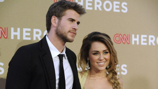 Miley Cyrus (R) and Liam Hemsworth are engaged. UPI/ Phil McCarten