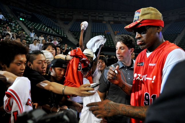 Dennis Rodman signs autograph after the game of street basketball against Japan's Somecity goes to S2E at the Ariake Colosseum in Tokyo, Japan, on August 19, 2010. UPI/Keizo mori