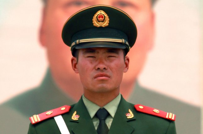 A Chinese soldier stands watch in front of Tiananmen Square's North Rostrum in Beijing. China is opposed to the deployment of a U.S. anti-missile defense system on the Korean peninsula and issued a strong warning Tuesday. File Photo by Stephen Shaver/UPI