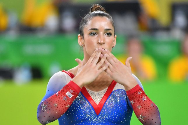 Aly Raisman of the United States blows a kiss after she competes and wins the silver medal in the floor exercise at the Olympic Arena of the 2016 Rio Summer Olympics in Rio de Janeiro, Brazil, August 16, 2016. Photo by Kevin Dietsch/UPI