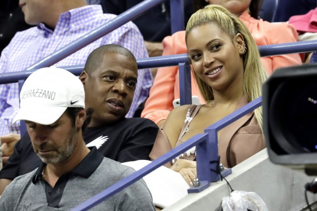 Beyoncé (R) and Jay Z watch Serena Williams play Vania King at the U.S. Open Tennis Championships on Thursday. Photo by John Angelillo/UPI
