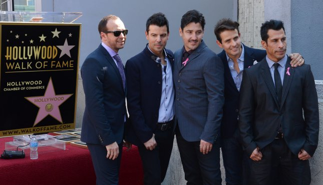 the latest fc9ed bc264 New Kids On The Block band members Donnie Wahlberg, Jordan Knight, Jonathan  Knight, Joey McIntyre and Danny Wood (L-R) gather around their star after  the ...