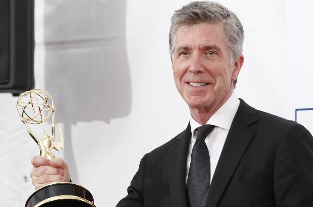 Dancing with the Stars host Tom Bergeron holds his Emmy backstage at the 64th Primetime Emmy Awards on September 23, 2012. Bergeron tried to call a truce between William Shatner and DWTS Season 24 contestant Nick Viall on social media. File Photo by Danny Moloshok/UPI