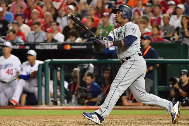 Seattle Mariners shortstop Jean Segura (2) hits a three-run homer against the National League during the eighth inning of the MLB All-Star Game on July 17 at Nationals Park in Washington, D.C. Photo by Kevin Dietsch/UPI