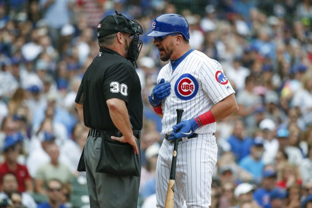 Chicago Cubs left fielder Kyle Schwarber argues with home plate umpire Rob Drake in an August 31 game against the Milwaukee Brewers at Wrigley Field in Chicago, Ill. File Photo by Kamil Krzaczynski/UPI