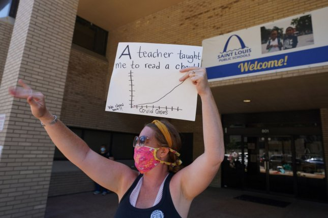 St. Louis Public School art teacher Carolyn Bryant of Patrick Henry School, waves as a car passes at St. Louis Public School headquarters on July 13. Several United Nations agencies said Monday the world needs to invest more in education. Photo by Bill Greenblatt/UPI