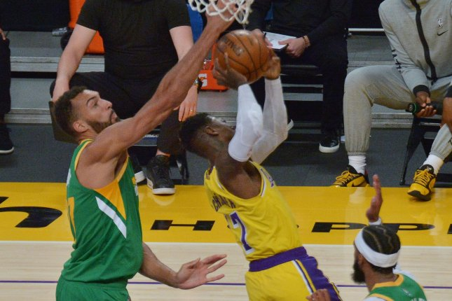 Utah Jazz center Rudy Gobert (L), shown April 19, 2021, becomes the fourth player in NBA history to win the DPOY award at least three times. File Photo by Jim Ruymen/UPI