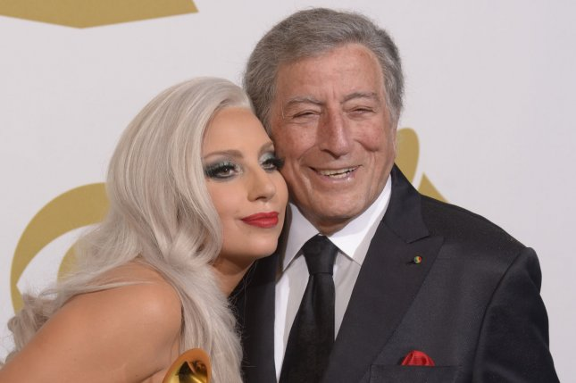 Lady Gaga and Tony Bennett appear backstage with the Grammy Awards they won for best Traditional Pop Vocal Album Cheek To Cheek at the 57th Grammy Awards at the Staples Center in Los Angeles on Feb. 8, 2015. File Photo by Phil McCarten/UPI