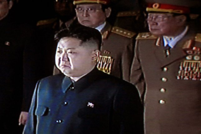China's state television shows footage of Kim Jong-un lduring the funeral for his father, Kim Jong-il, in 2011. North Korea conducted a failed test of a midrange ballistic missile system on Friday, it's seventh such test of the year. File photo by Stephen Shaver/UPI