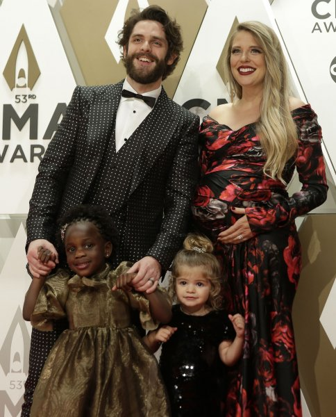 Thomas Rhett (top left), pictured with Lauren Akins (top right) and daughters Willa (L) and Ada, attends the Country Music Association Awards on Wednesday. Photo by John Angelillo/UPI