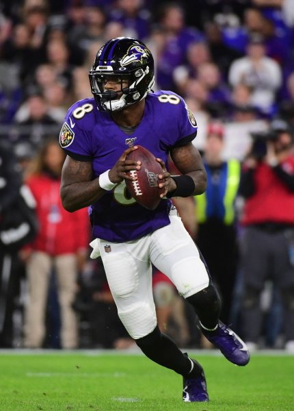Baltimore Ravens quarterback Lamar Jackson (8) scrambles against the Tennessee Titans in the second quarter of a divisional playoff game at M&T Bank Stadium in Baltimore, Md., on January 11. File Photo by Kevin Dietsch/UPI